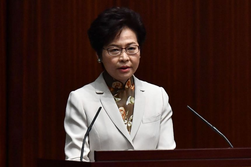 Hong Kong's Chief Executive Carrie Lam said she would address the city's astronomical housing prices by seeking to increase land supply and launch a new housing scheme to help families buy flats.