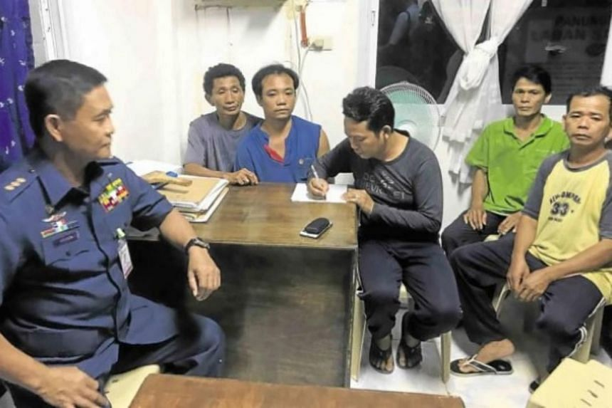 Five of the Vietnamese fishermen apprehended off Bolinao town during their interrogation by the Philippine Coast Guard.