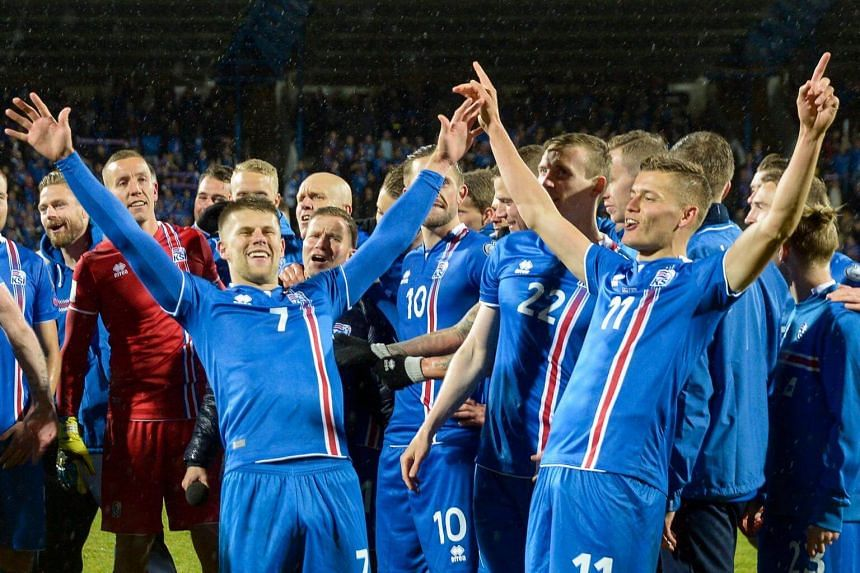 Iceland's players celebrate after the FIFA World Cup 2018 qualification football match between Iceland and Kosovo in Reykjavik, Iceland on Oct 9, 2017.