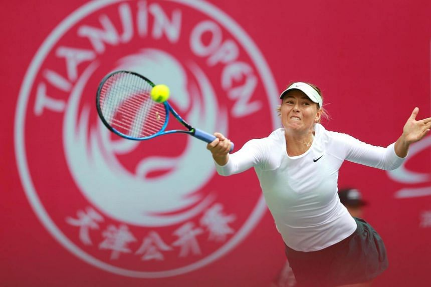 Maria Sharapova hits a return against Irina-Camelia Begu during their women's singles first round match at the Tianjin Open tennis tournament in Tianjin on Oct 11, 2017.
