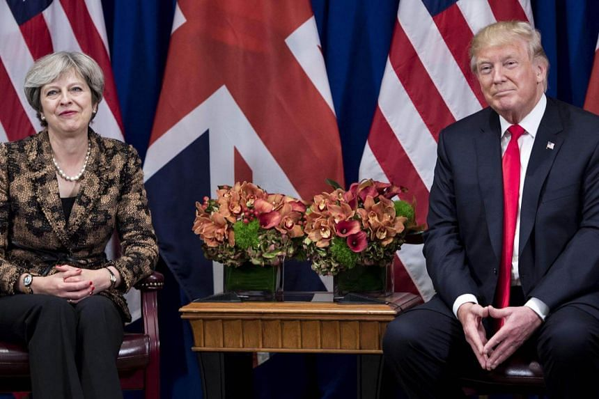 British Prime Minister Theresa May and US President Donald Trump at the Palace Hotel in New York on Sept 20, 2017.  Theresa May's office said the government's position on Mr Trump's State Visit has not changed.
