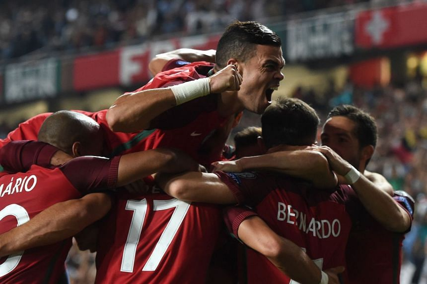 Portugal's defender Pepe celebrates wuith teammates after their second goal.