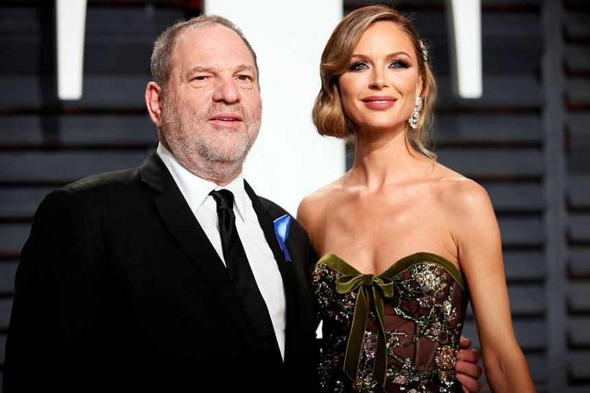 Harvey Weinstein and his wife, fashion designer Georgina Chapman pose for a picture during 89th Academy Awards.