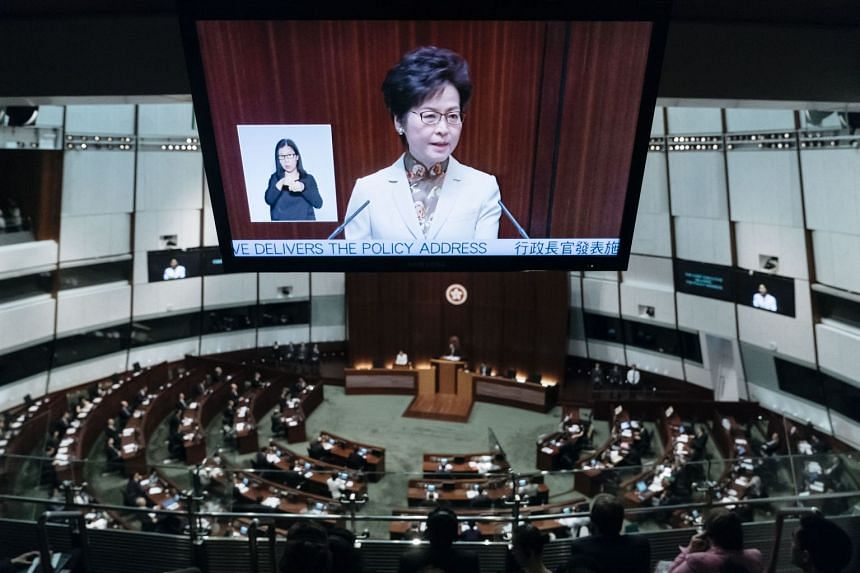 Mrs Carrie Lam, Hong Kong's Chief Executive, is seen on a screen while delivering a policy address in the chamber of the Legislative Council in Hong Kong, China, on Oct 11, 2017.
