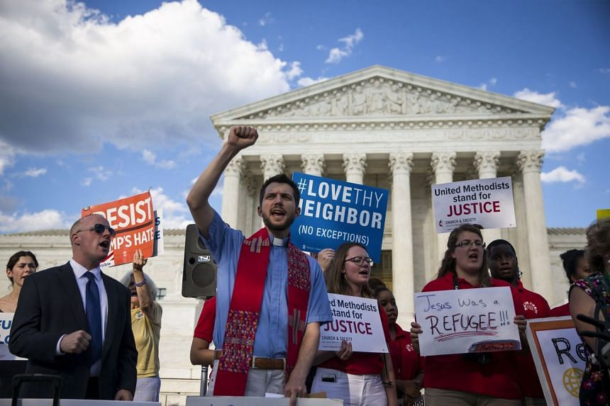 A file photo of demonstrators outside the US Supreme Court building in Washington, on June 26, 2017.