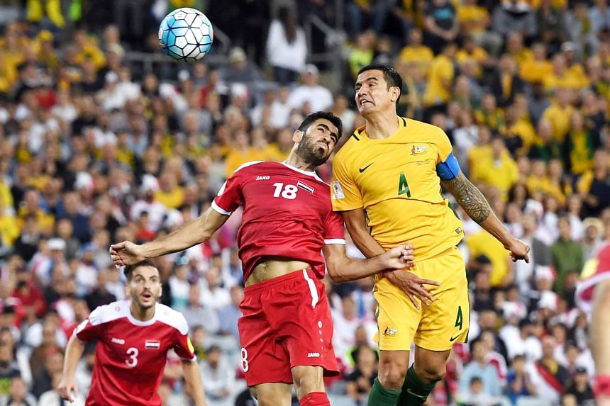 Clockwise, from left: Tim Cahill of Australia wins an aerial duel against Syria's Zaher Medani to head home the equaliser during the second leg of the World Cup qualifying play-off in Sydney yesterday. Referee Ravshan Irmatov sending Syria's Mahmoud