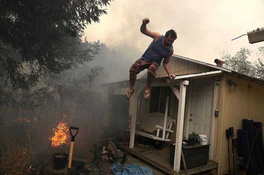 A resident trying to save his home on Monday as a wildfire moved through Glen Ellen in Sonoma county.