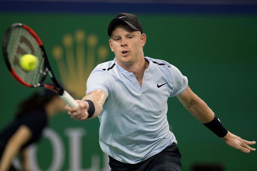 Kyle Edmund of Britain hits a return during the men's singles against Marin Cilic of Croatia at the Shanghai Masters tennis tournament in Shanghai, on Oct 10, 2017.