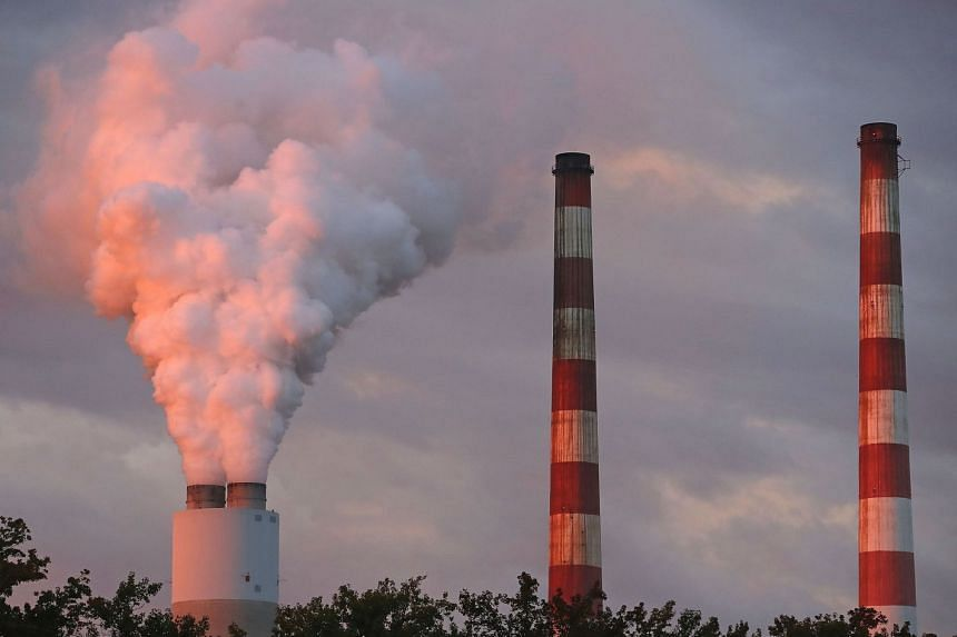 Emissions spew out of a large stack at the coal-fired Morgantown Generating Station on Oct 10, 2017 in Newburg, Maryland.