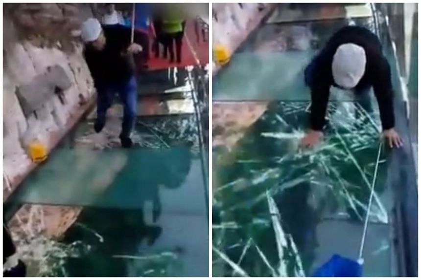 A tour guide was seen panicking in a video as glass panels on the bridge, which is more than 3,800ft above the ground, appeared to crack beneath his feet.