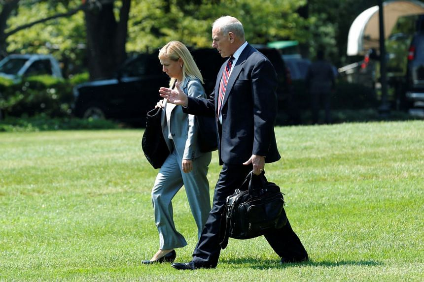 Kirstjen Nielsen walking with John Kelly across the South Lawn of the White House, Aug 22, 2017.