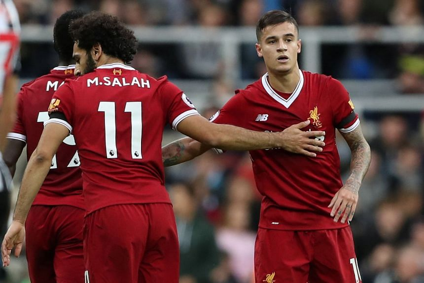 Liverpool's Philippe Coutinho celebrates a goal with Mohamed Salah.