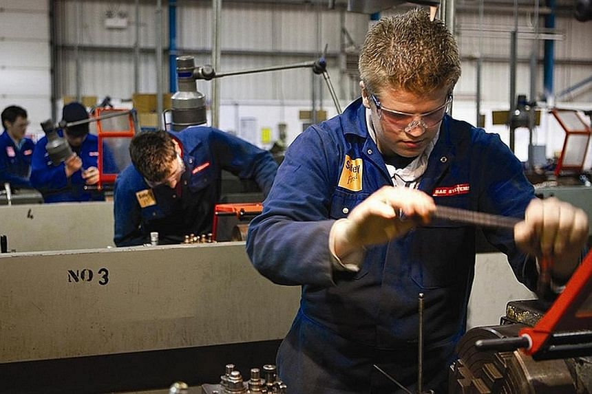 Apprentices working at a BAE Systems site in Warton, Lancashire, in Britain. BAE said it needed to reduce the workforce at this site and Samlesbury, where it makes parts for the Typhoon jet.