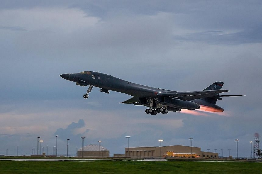 A US Air Force B-1B taking off from an airbase in Guam on Tuesday to fly with two Japan Air Self-Defence Force F-15s and two Republic of Korea Air Force F-15Ks over the Korean peninsula.