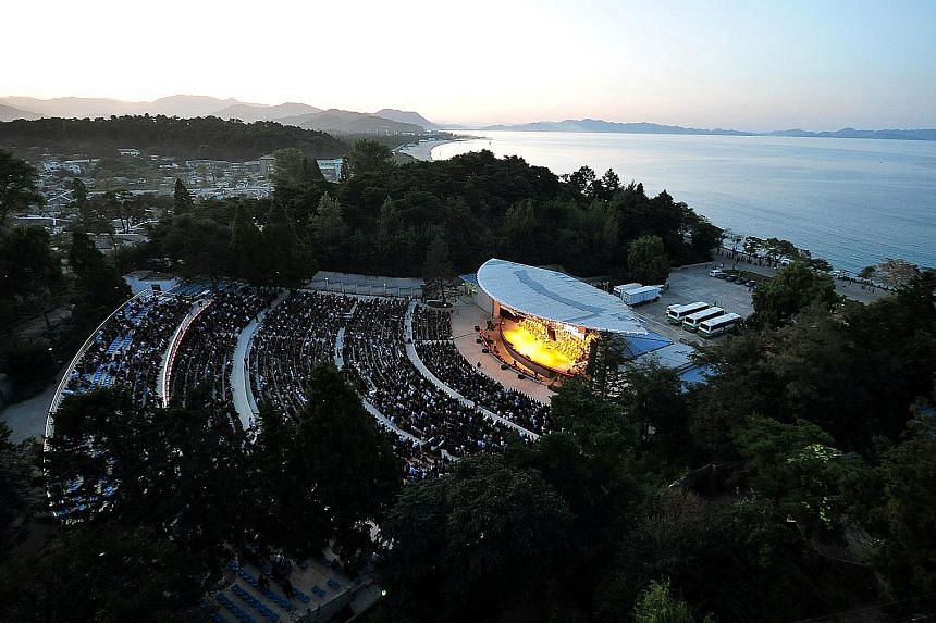 An open-air concert in North Korea's Wonsan city, Kangwon province. North Korean leader Kim Jong Un wants to turn the summer retreat into a billion-dollar tourist hot spot. At the same time, he has launched nearly 40 missiles from the area, as part o