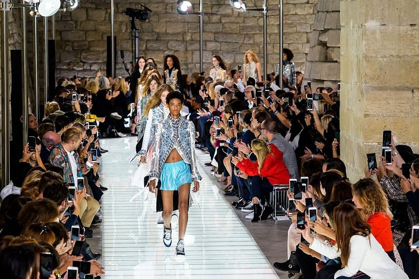 Models presenting French designer Nicolas Ghesquiere's Spring/Summer 2018 Ready to Wear collection for LVMH fashion house Louis Vuitton during Paris Fashion Week earlier this month.