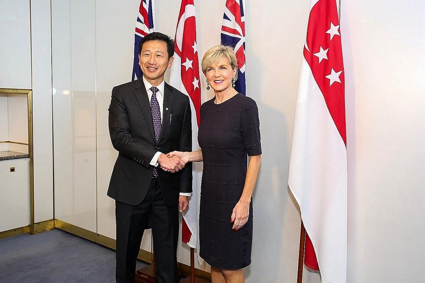 Mr Ong Ye Kung with Australia's Foreign Minister Julie Bishop on Tuesday. He also visited the Australian War Memorial and laid a wreath in honour of Australian soldiers who sacrificed their lives, including during the defence of Singapore in World Wa
