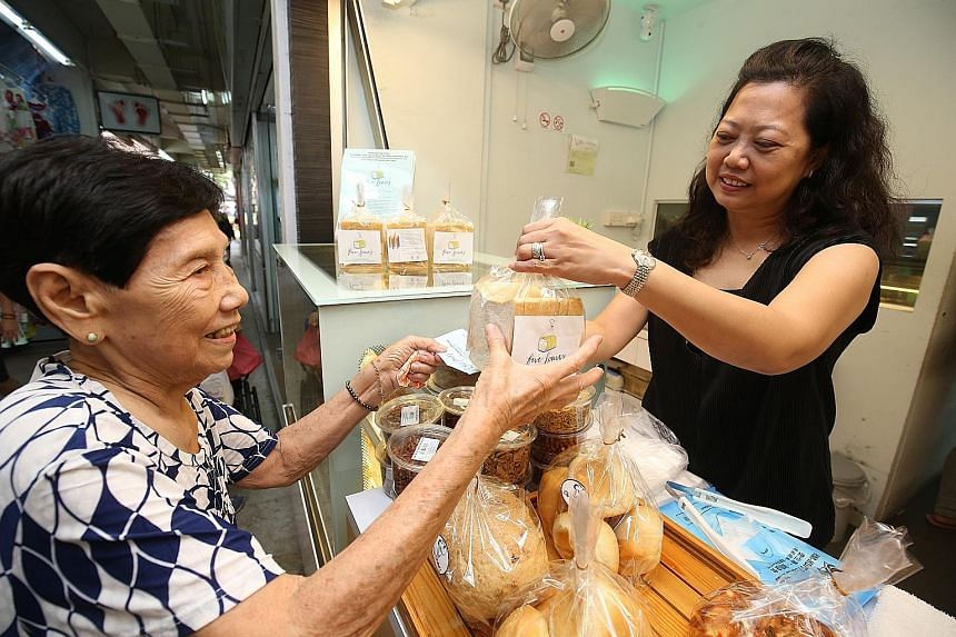 Since 2008, needy residents in the ward have been given $2 vouchers every weekend to buy food from participating Pek Kio Market stalls (above) as well as two nearby coffee shops. Meanwhile, a new app will be launched to connect residents keen on volu