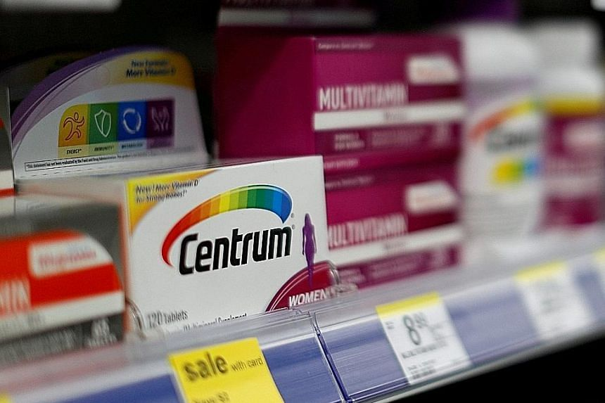 Centrum vitamins, a Pfizer brand, at a store in the US. Pfizer's consumer healthcare business, whose brands include painkiller Advil and lip balm ChapStick, had revenue of about US$3.4 billion (S$4.6 billion) last year.