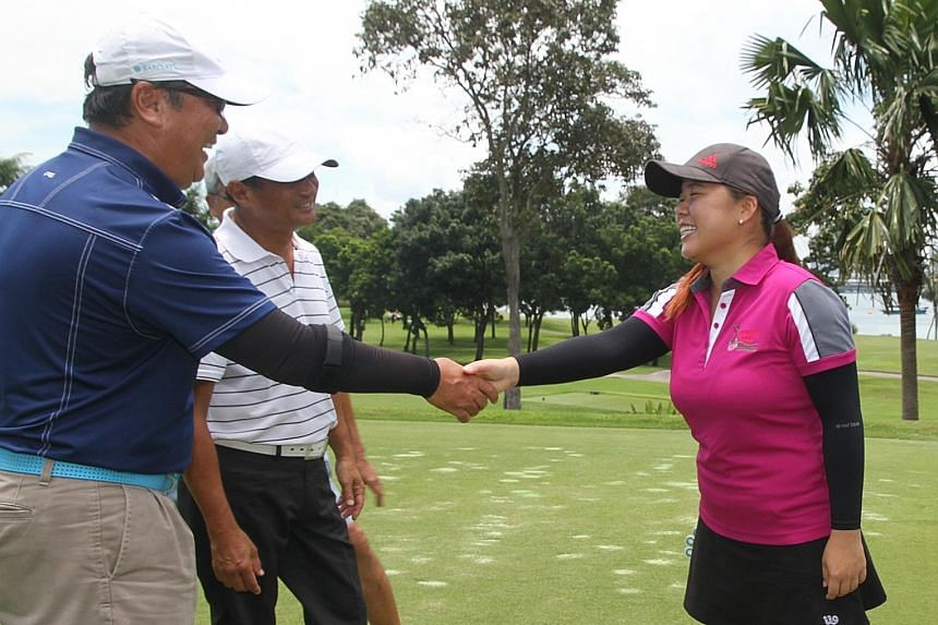 Former national golfer and YGP alumna Joey Poh meeting donors at yesterday's fund-raiser at Sentosa Golf Club.