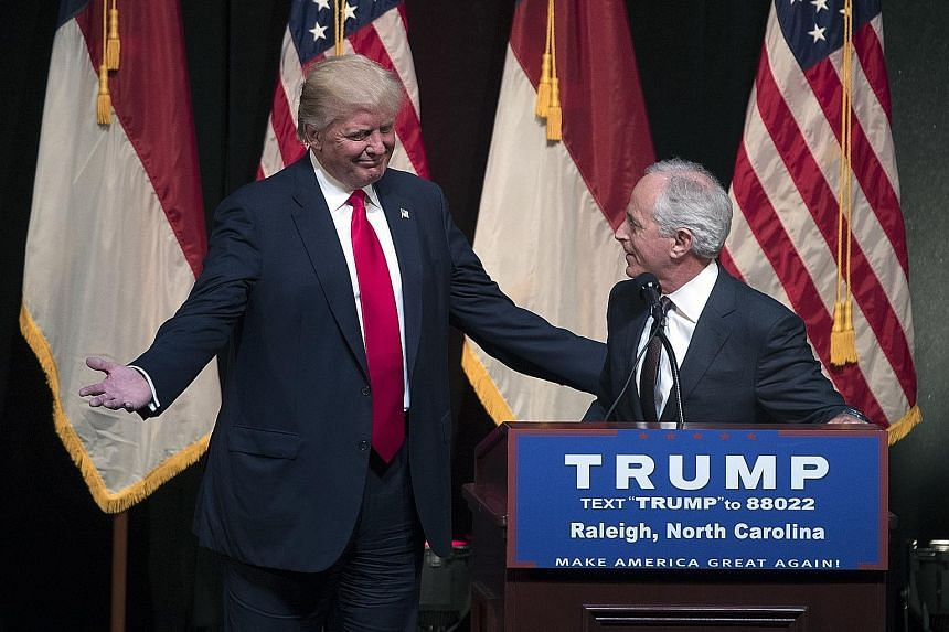 Senator Bob Corker introducing Mr Donald Trump, then a presidential candidate, at a campaign rally in North Carolina, in July last year.