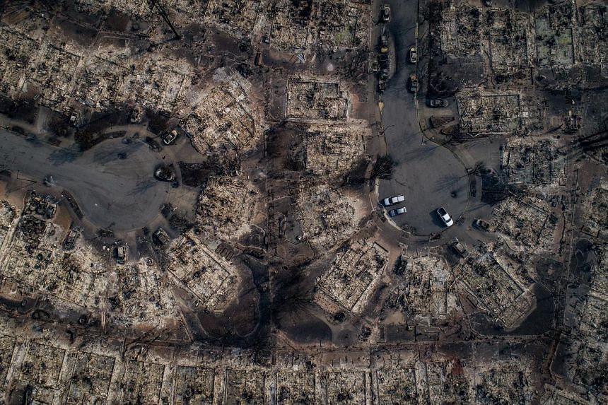 An aerial view of homes burnt by wildfire in a Santa Rosa neighbourhood on Tuesday. Flames from 17 blazes have blackened over 46,500 ha in California since fires broke out last Sunday.