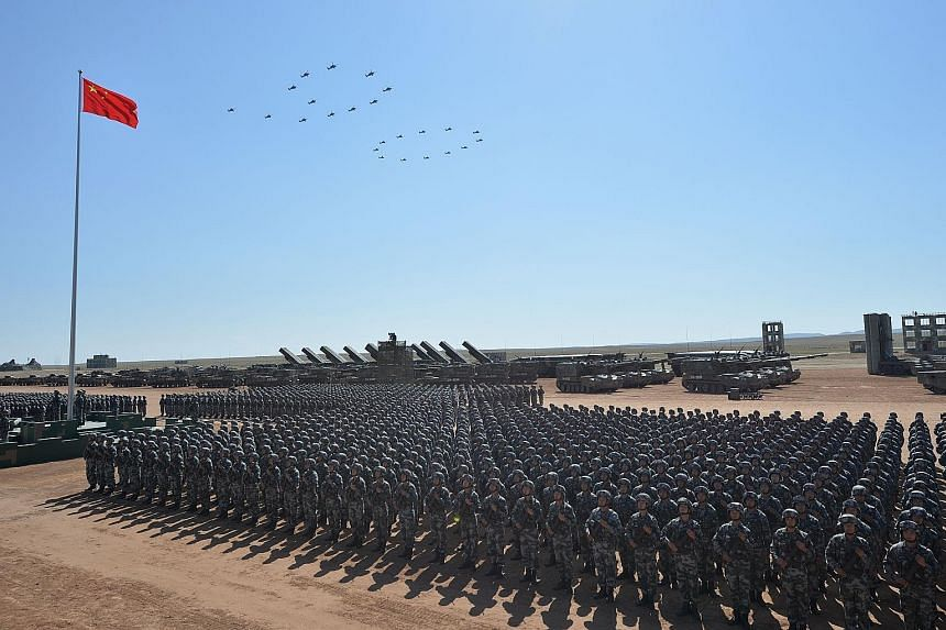 """Military helicopters forming the number """"90"""" during a parade of the Chinese armed forces at the Zhurihe training base in the country's northern Inner Mongolia region on July 30 to mark the 90th anniversary of the People's Liberation Army."""