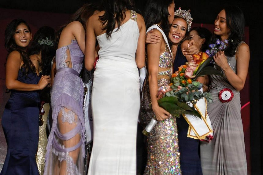 Winner Manuela Blanka Bruntraeger (second from right) is congratulated by contestants after being crowned Miss Universe Singapore 2017 on Oct 11, 2017.