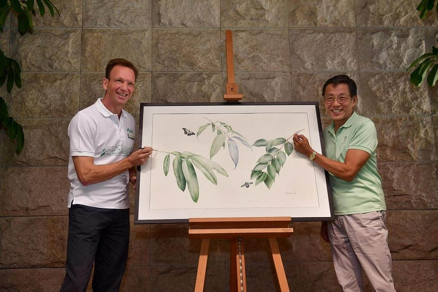 Mr Mike Barclay (left), group executive of Mandai Park Holdings and Mr Ho Kwon Ping, Executive Chairman of Banyan Tree Holdings posing in front of a piece of botany artwork, on Oct 11, 2017.