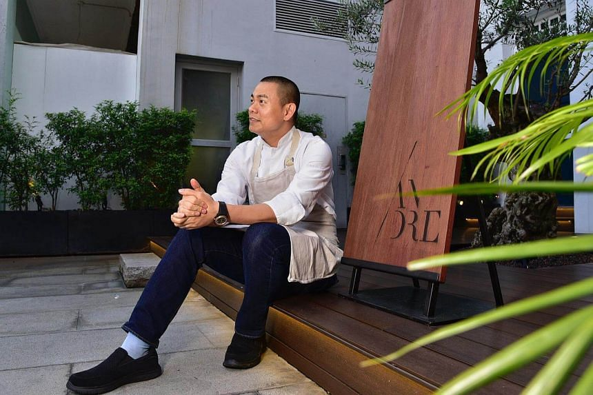 Chef-owner Andre Chiang posed outside his two-Michelin-starred Restaurant Andre.