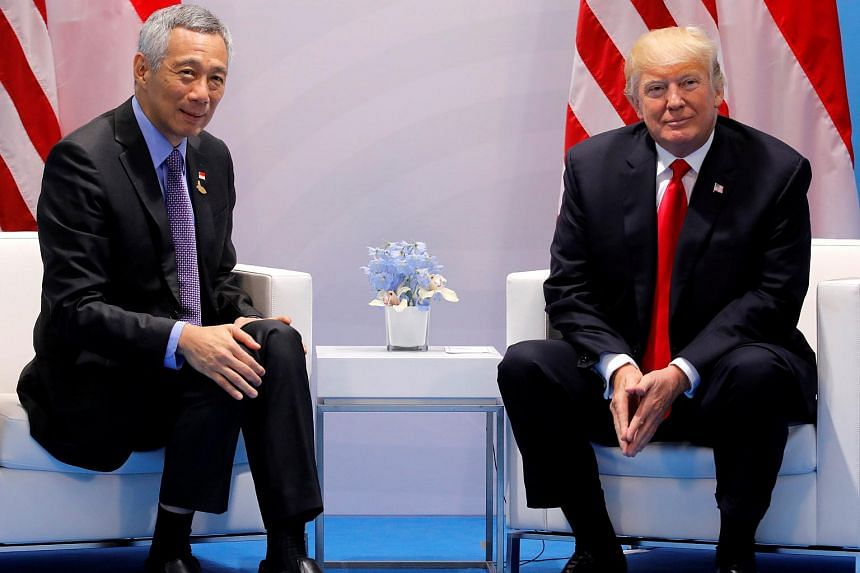 Singapore's Prime Minister Lee Hsien Loong talks with US President Donald Trump during the G-20 leaders summit in Hamburg, Germany, on July 8, 2017.