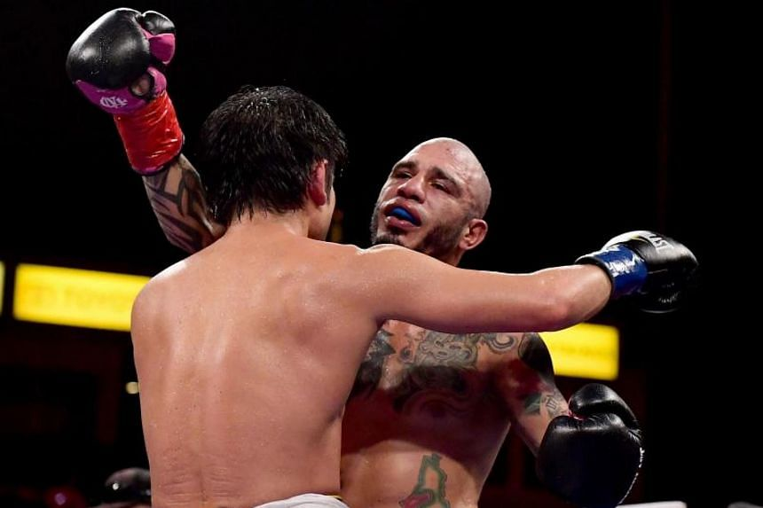 Miguel Cotto receives a hug from Yoshihiro Kamegai after a 12 round unanimous decision to retain the WBO Junior Middleweight title at StubHub Center on  in Carson, California on Aug 25, 2017.