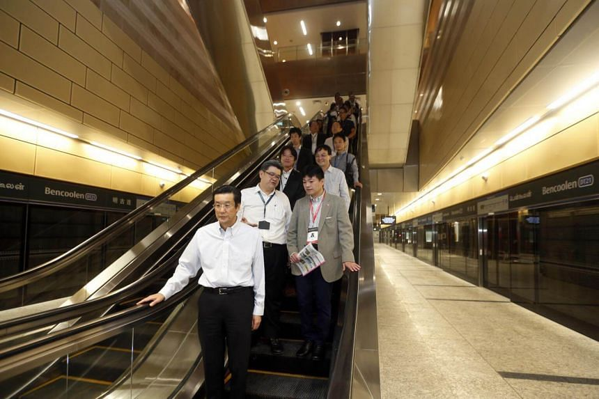 The international affairs special representative for Japan's Ministry of Land, Infrastructure, Transport and Tourism Masayoshi Isono (in brown) visits the Bencoolen MRT Station.