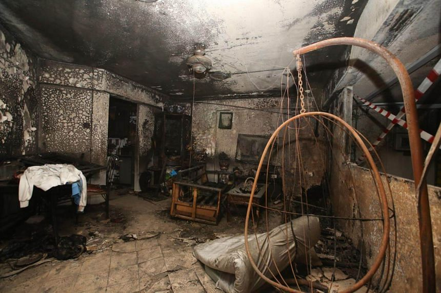 The living room and corridor were razed by the fire, which SCDF put out with a water jet.