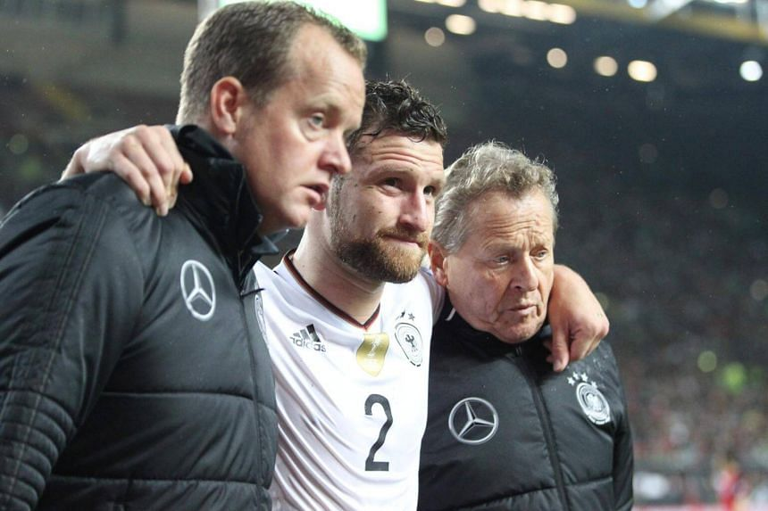 Medical staff help off injured Germany's defender Shkodran Mustafi (centre) during the FIFA World Cup 2018 qualification football match between Germany and Azerbaijan in Mainz, western Germany, on Oct 8, 2017.