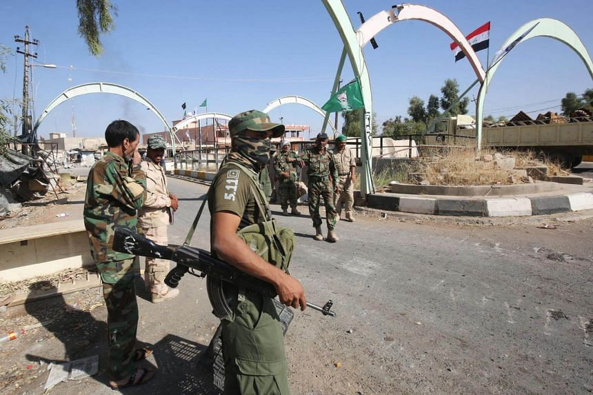 Fighters from the Hashed al-Shaabi, backing the Iraqi forces, hold a position in Hawija on Oct 6, 2017.  The Kurdistan Regional Government's Security Council said they received messages that the Hashed al-Shaabi and federal police are preparing a m