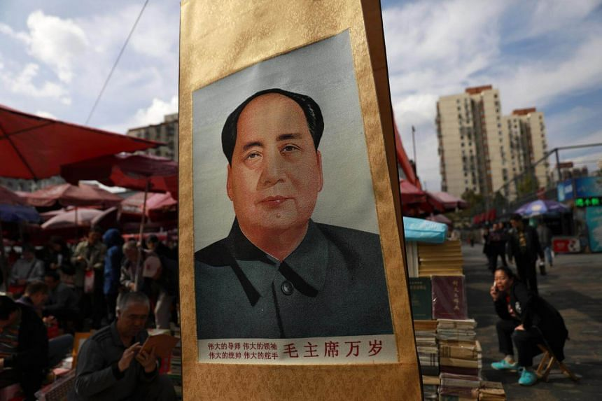 A painting of former Chinese Communist Party leader Mao Zedong is seen displayed in a stall at Panjiayuan Antique market in Beijing, China, on Oct 11, 2017.
