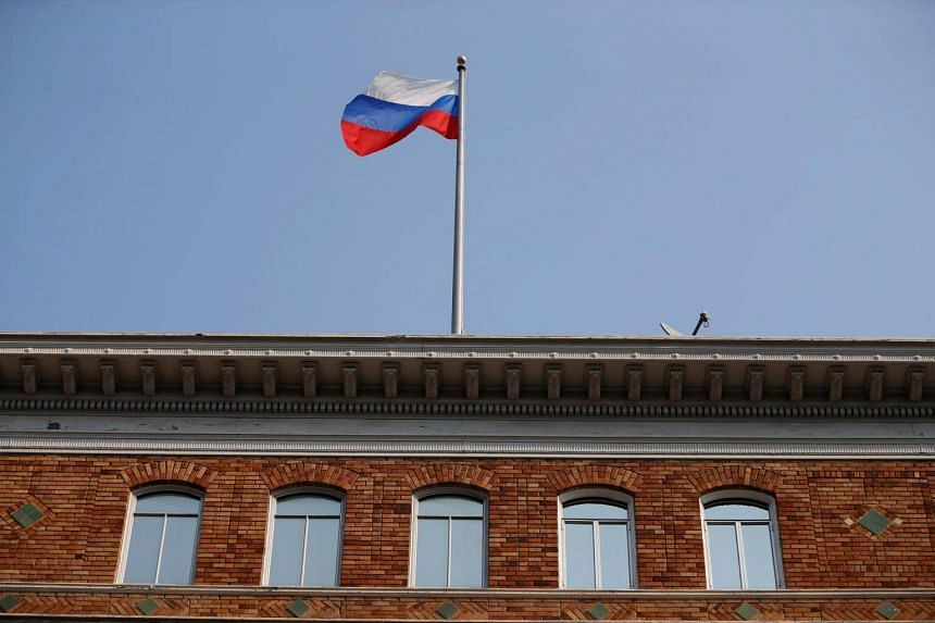 """The Russian flag on the rooftop of the Consulate General of Russia in San Francisco on Sept 2, 2017. Russia's Foreign Ministry spokeswoman Maria Zakharova said Russian flags """"had been torn off the buildings of Russia's trade mission in Washington and"""