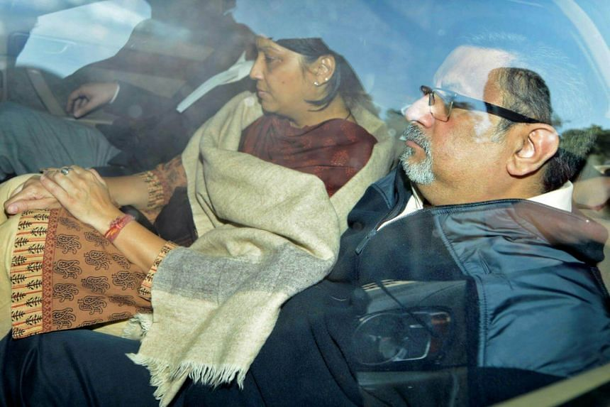 Dentists Rajesh and Nupur Talwar being taken to court in Ghaziabad, on the outskirts of New Delhi, on Nov 25, 2013.