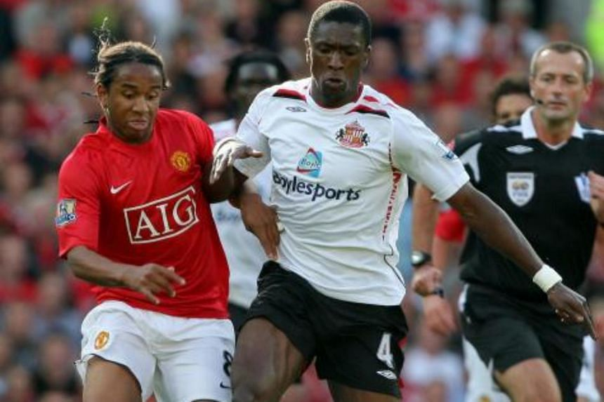 Dickson Etuhu (right), a football agent and former Nigeria midfielder who played for Manchester City, Sunderland and Fulham during his Premier League career, is at the centre of an inquiry into match-fixing.