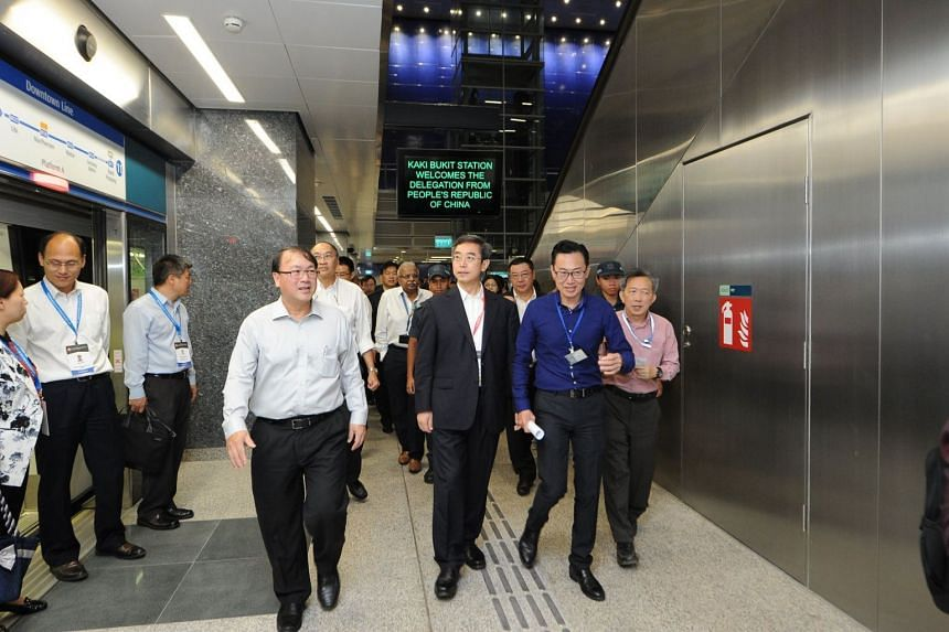 The delegation from the People's Republic of China, led by Mr Dai Dongchang, Vice-Minister of Transport, takes a tour of a new Downtown Line station.