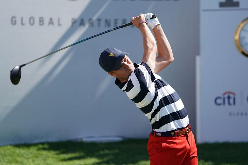 Justin Thomas tees off on the first hole during the final round singles matches of The President's Cup golf tournament at Liberty National Golf Course in Jersey City, New Jersey, USA, on Oct 1, 2017.