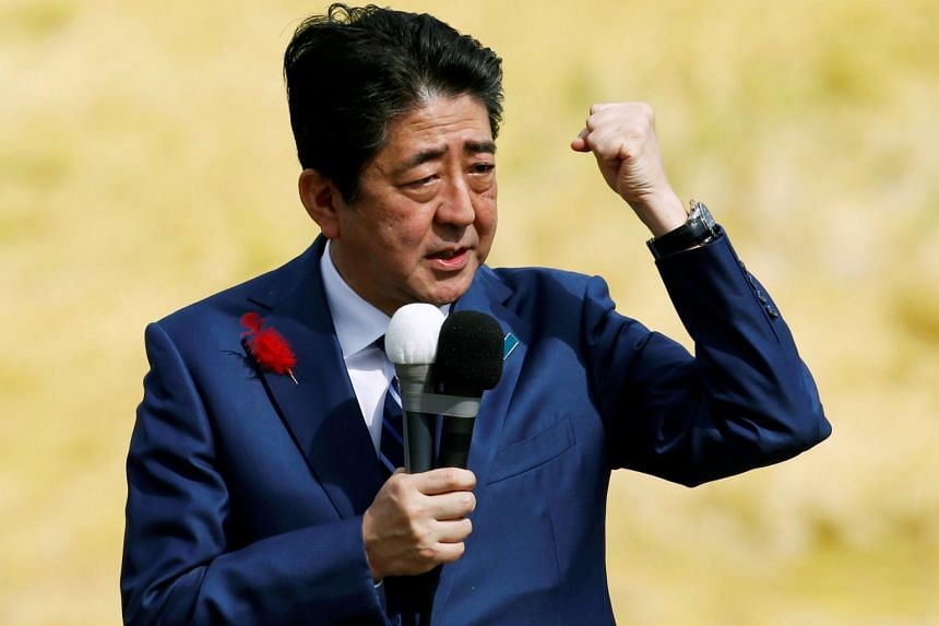 Japan's Prime Minister Shinzo Abe, who is also ruling Liberal Democratic Party leader, attends an election campaign rally in Fukushima, Japan, on Oct 10, 2017.