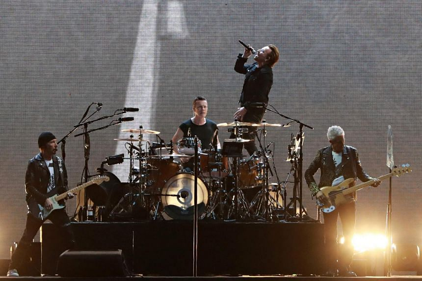 (From left) The Edge, Larry Mullen Jr, Bono and Adam Clayton of Irish rock band U2 perform on stage at the Stade de France in Saint-Denis, outside Paris, on July 25, 2017.
