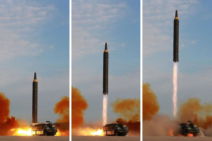 An undated combination picture released from North Korea's official Korean Central News Agency (KCNA) on Sept 16, 2017,  shows a launching drill of the medium-and-long range strategic ballistic rocket Hwasong-12.