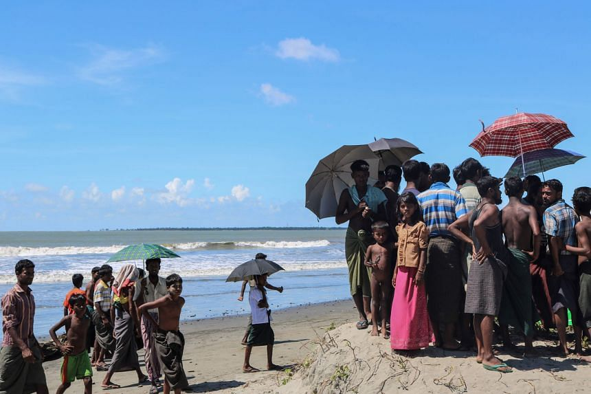 Rohingya refugees near Gaw Du Thar Ya village in Maungdaw, in northern Rakhine, waiting to cross the border to Bangladesh. The writer says that dismissing the Rohingya as Bengalis squatting on Myanmar soil, as the Myanmar authorities are wont to do,
