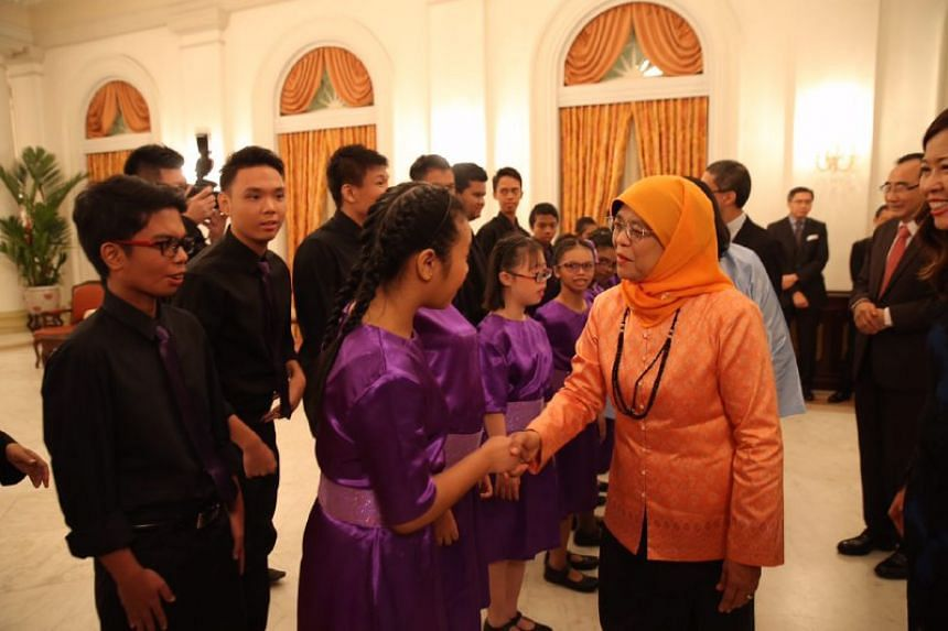President Halimah Yacob meeting performers from Minds Lee Kong Chian Gardens School Choir prior to their performance at Community Chest Awards at the Istana.