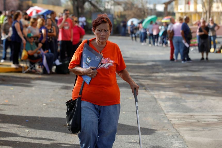 Residents affected by Hurricane Maria wait to receive and register for unemployment benefits in Puerto Rico, Oct 12, 2017.