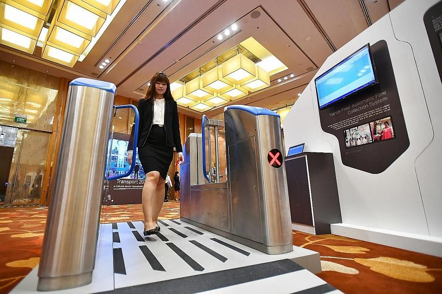 Some MRT stations next year will test out a new payment system (above) that does not require a card to be tapped at a gate.