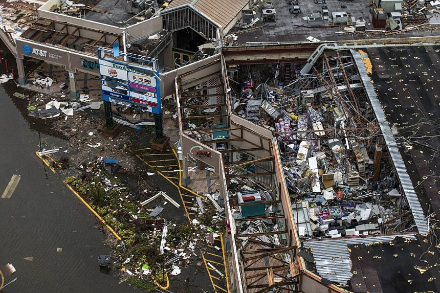 US monetary policymakers say the economic effects of hurricanes Harvey, Irma and Maria, which tore a path of destruction across US territories including Puerto Rico (above) in August and September, were likely to be only temporary.
